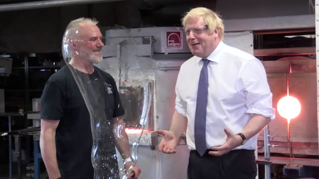 footage from friday's cabinet meeting at the national glass centre in sunderland. boris johnson attempts blowing glass, making a glass picture and... - friday stock videos & royalty-free footage
