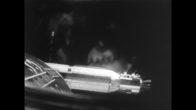 footage from Gemini 8 camera showing the rendezvous with Agena rocket / Gemini enters docking collar of Agena / thruster malfunction and the Agena...