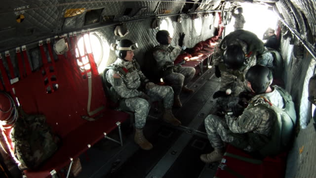 Footage from inside a CH-47 Chinook helicopter transporting paratroopers.