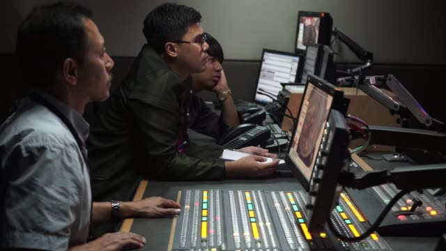 footage from inside a control room at the headquarters of astro malaysia holdings bhd. in kuala lumpur, malaysia, on monday, july 7, 2015. shots: man... - editor stock videos & royalty-free footage