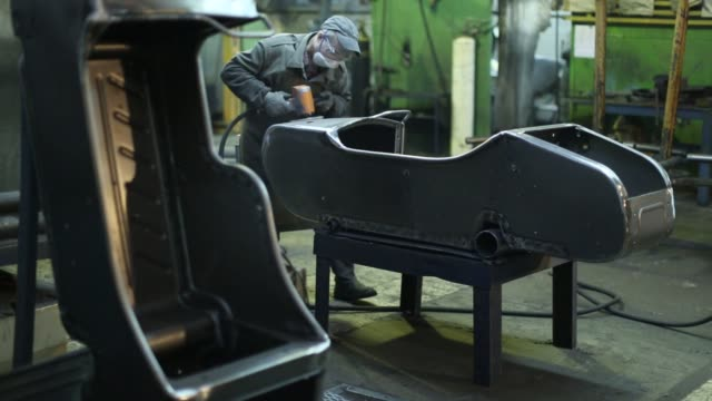 footage from inside the irbit motorworks factory in irbit russia december 10 2015 shots several similar shots of two female workers buffing side car... - sidecar stock videos & royalty-free footage