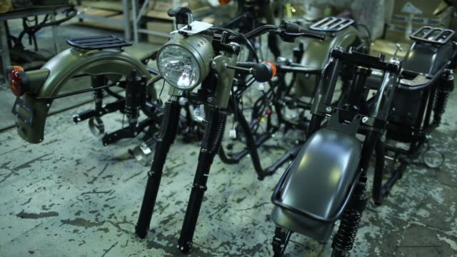 footage from inside the irbit motorworks factory in irbit russia december 10 2015 shots tracking shot of man riding motorcycle with side car full... - workbench stock videos & royalty-free footage
