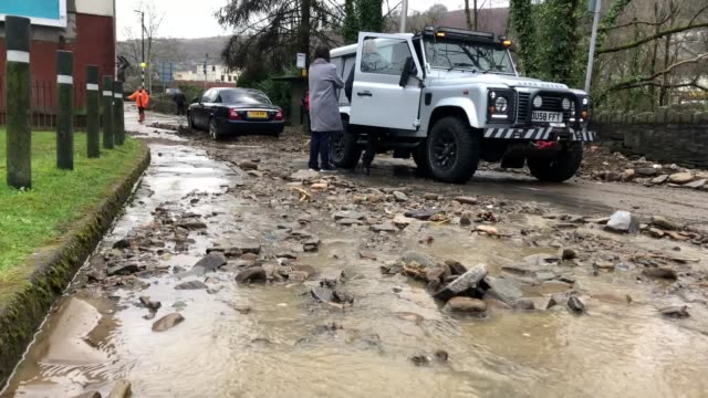 footage from mountain ash in south wales where where a culvert has burst, causing flooding across the village. the news comes after storm dennis... - risk stock videos & royalty-free footage