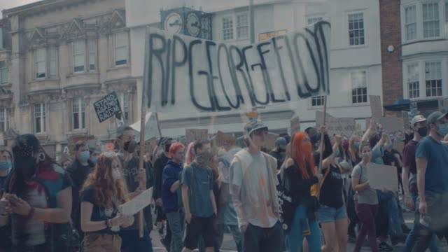 footage from the black lives matter protest in bristol, england on june 7th 2020, sparked by the death of george floyd and the continued oppression... - イングランド南西部点の映像素材/bロール