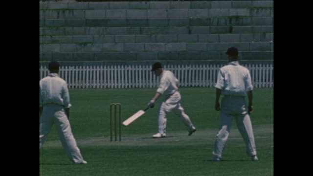 stockvideo's en b-roll-footage met footage from the british timken cricket tour of south africa, featuring jock livingston batting, circa february 1951. in 1898 the timken industrial... - cricketveld