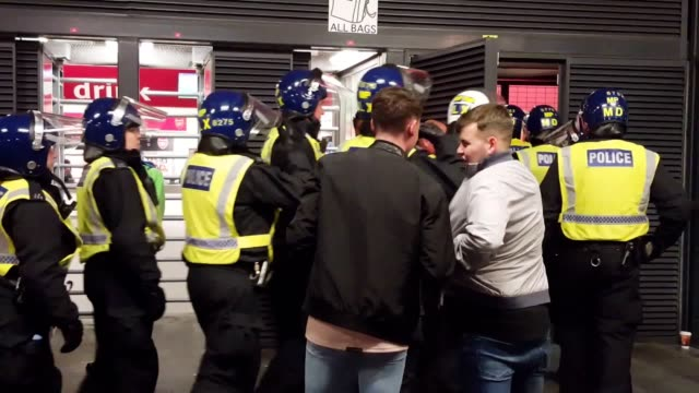 Footage from the Emirates stadium where riot police arrive to deal with trouble between Arsenal and FC Cologne fans