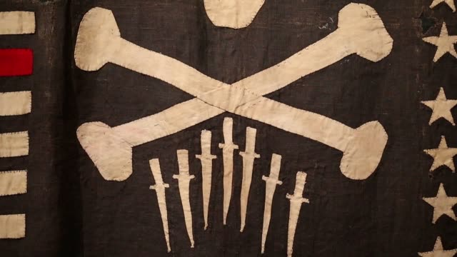 Footage from the Jolly Roger exhibition at the National Museum of the Royal Navy in Portsmouth The new exhibition tells the story of the skull and...