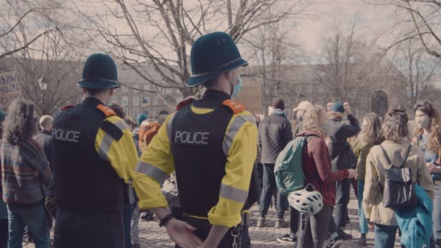 footage from the kill the bill protest in bristol, uk during coronavirus covid-19 lockdown on march 21st 2021, with a march through the city center... - group of people stock videos & royalty-free footage