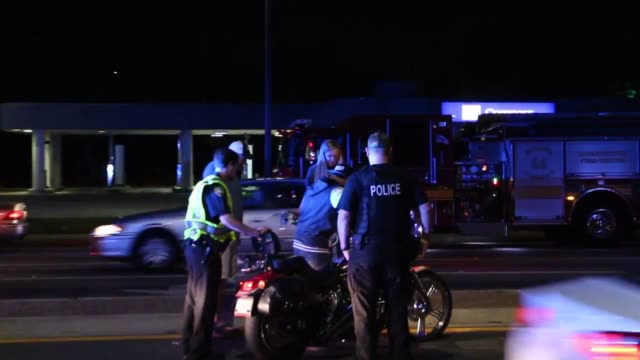 footage from the scene of an accident on baymeadows road, two motorcycles were hit by a car that fled the scene. - jacksonville florida video stock e b–roll
