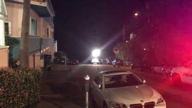 stockvideo's en b-roll-footage met footage from the scene of an officer involved shooting in laguna beach a police officer pulled over a car and a woman got out of the car with a gun... - laguna beach californië