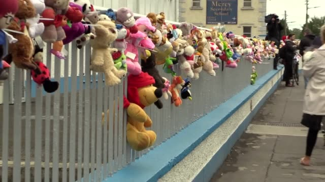 footage from the silent vigil at the former site of tuam mother and baby home where toys were tied to railings as people passed along the route. - one parent stock videos & royalty-free footage