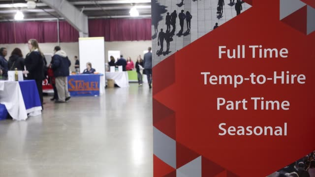 stockvideo's en b-roll-footage met footage from the southwest michigan job fair of a full time temptohire part time seasonal hiring sign at the kalamazoo county expo center in... - banenbeurs