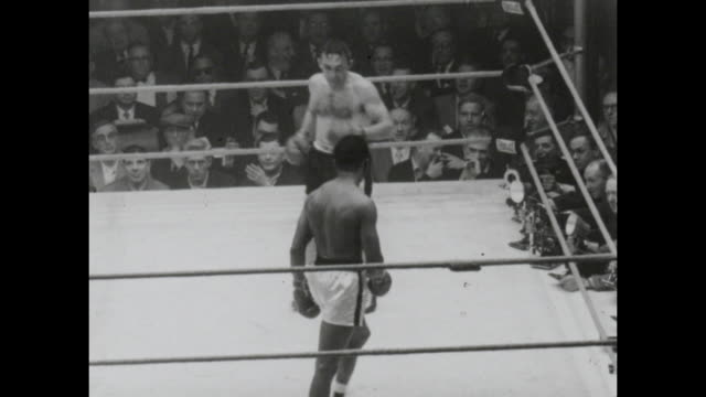footage from the sugar ray robinson vs carmen basilio middleweight world championship title fight in chicago stadium chicago on march 25th 1958... - 1958 stock videos & royalty-free footage
