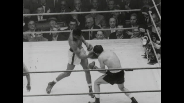 footage from the sugar ray robinson vs carmen basilio middleweight world championship title fight in chicago stadium chicago on march 25th 1958... - boxing ring stock videos & royalty-free footage