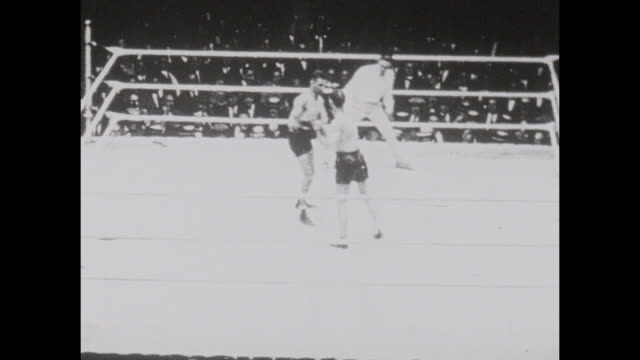 footage from the world heavyweight championship bout fought by benny leonard vs lew tendler in jersey city new jersey on july 27th 1922 - world championship stock videos & royalty-free footage