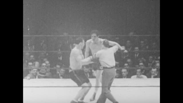 footage from the world heavyweight championship bout fought by primo carnera vs max baer in new york on 14th june 1934 - world championship stock videos & royalty-free footage