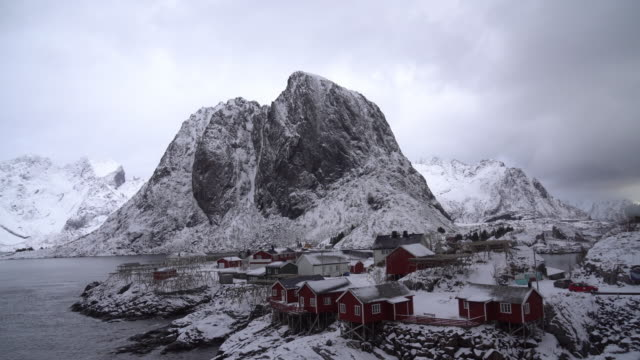 4k footage from top view show the sea with winding of hamnoy village in lofoten islands, norway - scandinavian culture stock videos and b-roll footage