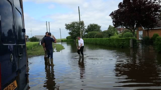 footage from wainfleet in lincolnshire where the number of people evacuated from the area because of heavy flooding stands at 590 as the cleanup... - lincolnshire stock videos & royalty-free footage