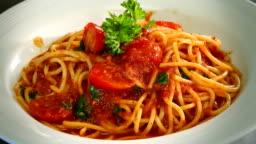 4K footage, hand chef preparing spaghetti on dish