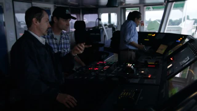 footage inside the cockpit of the claude adesgagnes a container ship from groupe desgagnes with a total capacity of 20000 cubic meters on the st... - 船長点の映像素材/bロール