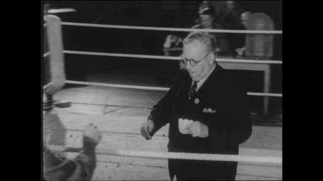 footage of a 1950s boys boxing match the mc is given the scores by the judges and declares the winner the boys shake hands with the spectators... - gesellschaftsgeschichte stock-videos und b-roll-filmmaterial