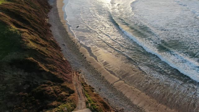 4k footage of a beach as seen from above - seascape stock videos & royalty-free footage