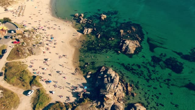 4k footage of a beach with people in summer - galicia stock videos & royalty-free footage