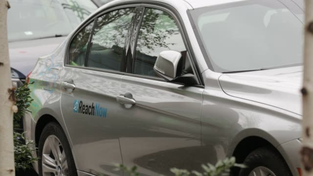 Footage of a BMW 328xi electric vehicle part of the ReachNow carshare program parked in Seattle Washington US on Monday April 11 2016 Shots shot of...