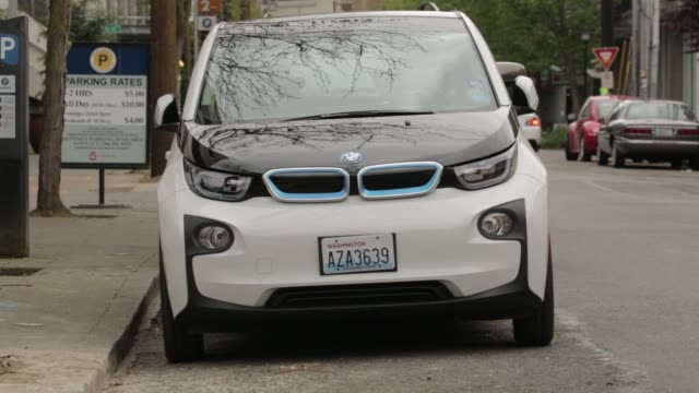 footage of a bmw i3 electric vehicle , part of the reachnow car-share program, parked in seattle, washington, u.s., on monday, april 11, 2016 shots... - stationary stock-videos und b-roll-filmmaterial