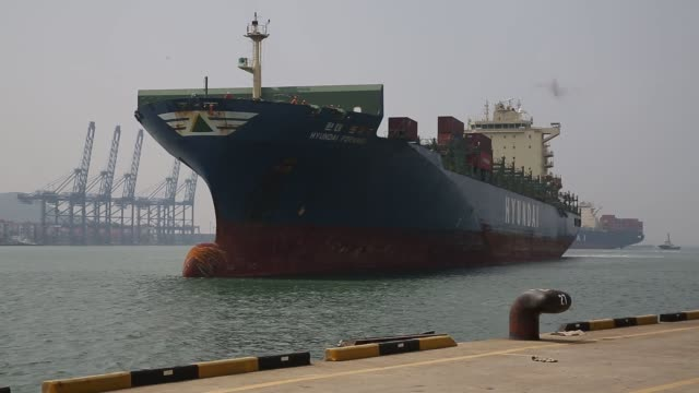 Footage of a boat arriving at a container terminal in Busan South Korea on September 9 Shots several similar shots of large container vessel coming...