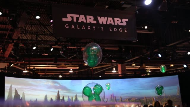 Footage of a booth advertising the Walt Disney Co Star Wars Galaxy's Edge themed area being developed at Disneyland Park is displayed at the D23 Expo...