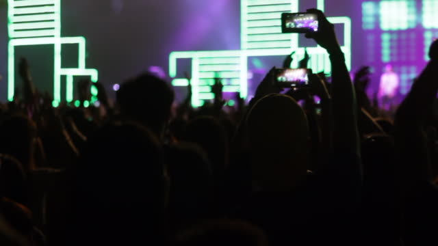 footage of a crowd partying, dancing at a concert - popular music concert stock videos & royalty-free footage