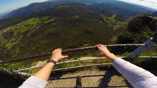 stockvideo's en b-roll-footage met footage of a guy from personal perspective with wearable camera recording the view from stunning viewpoint and nice landscape in the mountain region of collsacabra in the catalonia region during a road trip in the zone. - menselijke arm