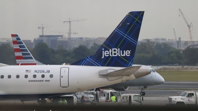Footage of a JetBlue signage on tail fin of aircraft viewed from inside boarding area at Ronald Reagan National Airport in Washington DC US on Friday...