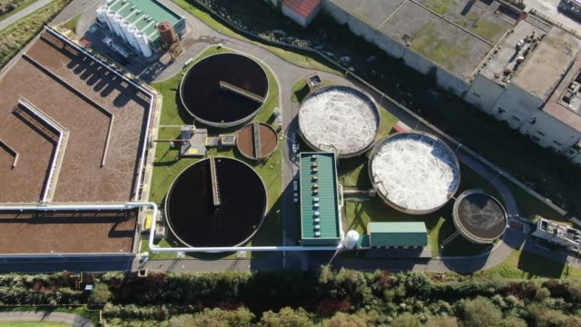4k footage of a large sewage treatment plant as seen from above - air vehicle stock videos & royalty-free footage