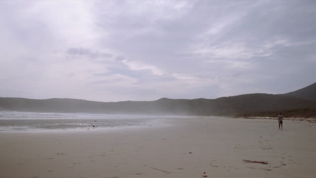 4K footage of a man walking on the beach and having fun, Wilson Promontory, Victoria, Australia