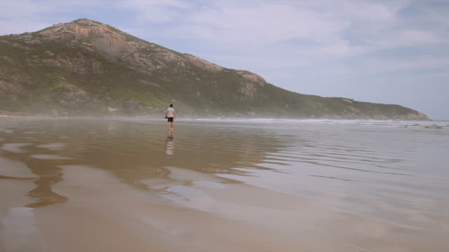 4K footage of a man walking on the beach and having fun, Wilson Promontory