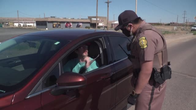 footage of a navajo police checkpoint in chinle, arizona, as the navajo nation is under strict lockdown this weekend, with a 57-hour curfew until... - navajo culture stock videos & royalty-free footage