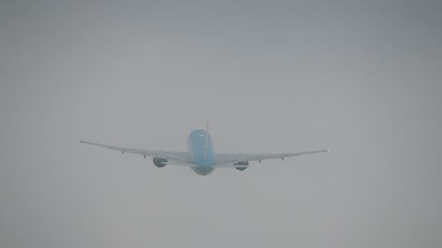 footage of a passenger aircraft disappearing into the clouds right after take off - fade out video transition stock videos & royalty-free footage