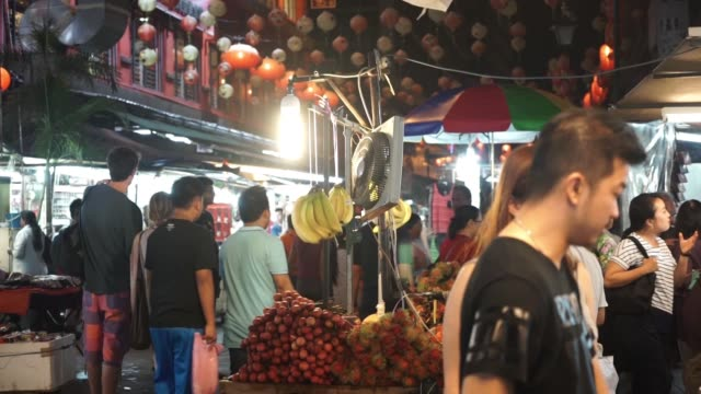 footage of a populated market at night in kuala lumpur, malaysia on september 29, 2015. shots: man fills plate with food on skewers at food stand,... - kuala lumpur stock videos & royalty-free footage