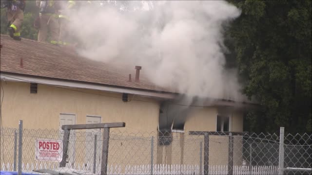 footage of a residential fire in lemon grove. the woman was sleeping at the time and was pulled out of a window by first responders . the cause of... - fire protection suit stock videos & royalty-free footage