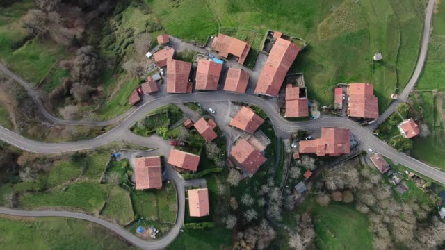 4k footage of a village as seen from directly above - zoom in stock videos & royalty-free footage