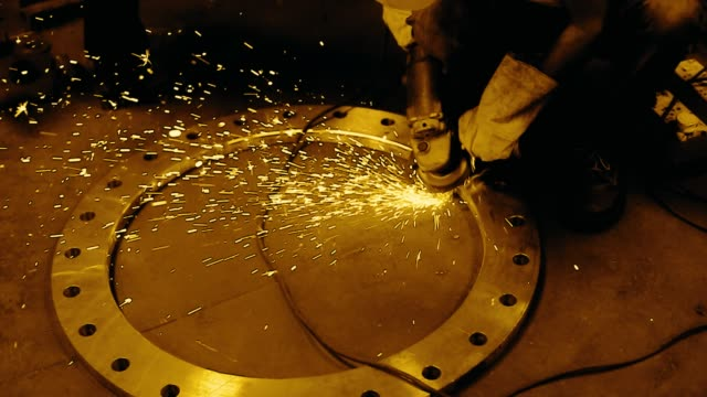 footage of a worker grinding a circular steel ring - welder stock videos & royalty-free footage