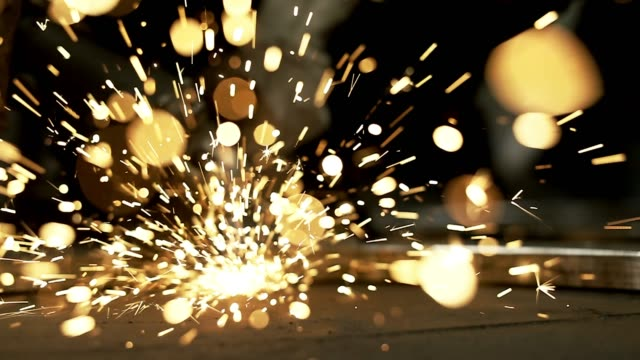 footage of a worker grinding a sheet of metal - sparks stock videos & royalty-free footage