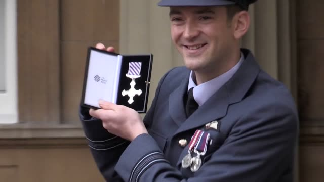 Footage of actress Sarah Lancashire and Squadron Leader Roger Cruickshank Royal Air Force after recieving their honours at Buckingham Palace...