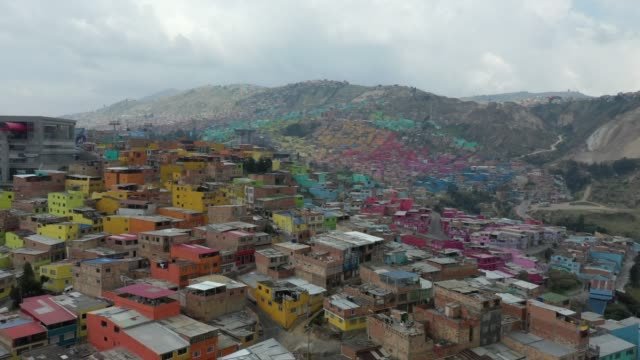 footage of aerial view of bogota slums during coronavirus preventive quarantine shows ciudad bolivar colorful houses - slum stock-videos und b-roll-filmmaterial