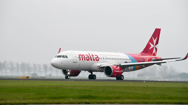 footage of air malta airbus a320 taking off on cloudy day - editorial stock videos & royalty-free footage
