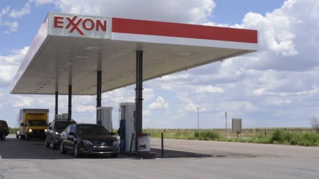 footage of an exxon gas station outside auroa new mexico on july 26 2016 shots shot of truck with uhaul behind being refilled wider shot of truck... - exxon stock videos & royalty-free footage