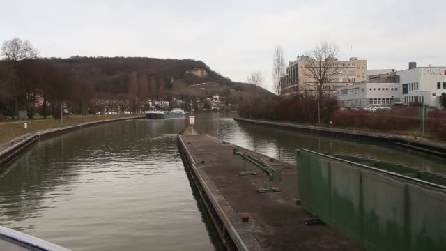 footage of an oil tanker barge and the caland canal as workers labor over pipes of refined oil in rotterdam, netherlands, on sunday, feb 14, 2016... - moving up点の映像素材/bロール