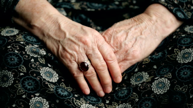 footage of an old wrinkled female hands with a big old ring on finger - mourner stock videos and b-roll footage